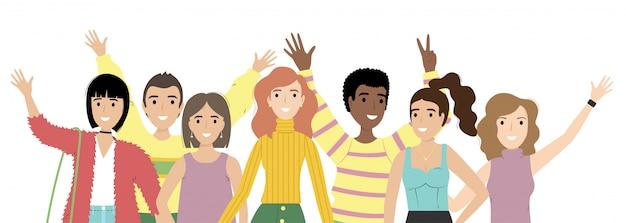 Portret grupy uśmiechniętych dziewcząt i chłopców lub studentów stojących razem.