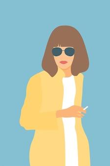 Portret kobiety w okularach przeciwsłonecznych.