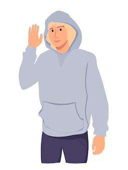 """Portret przyjaznego uśmiechniętego nastolatka machającego podniesioną ręką, mówiącego """"cześć"""" i wyglądającego na szczęśliwego powitania"""