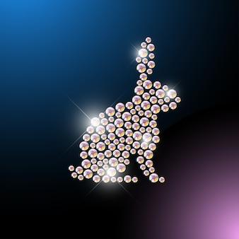 Portret zwierząt wykonany z klejnotów rhinestone na białym na czarnym tle. logo zwierząt, ikona zwierząt. wzór biżuterii, produkt ręcznie robiony. lśniący wzór. sylwetka zwierzęcia, siedzący króliczek.