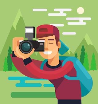 Postać fotografa robi zdjęcie natury.