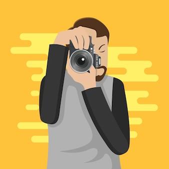 Postać fotografa robi zdjęcie