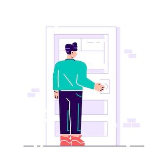 Postać męska trzyma klamkę. wejście do budynku