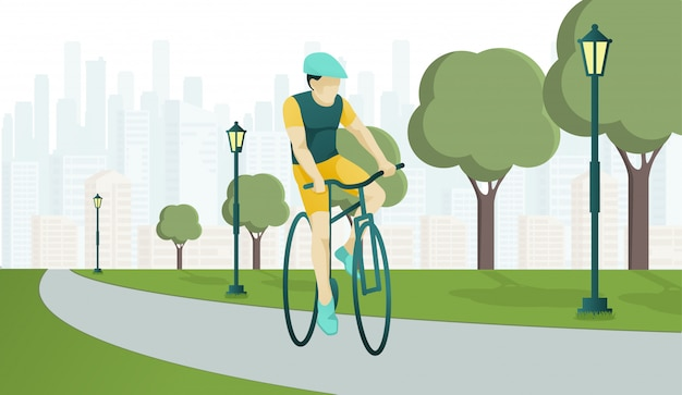 Postać młodego człowieka jeździ rowerem sportowym na park road