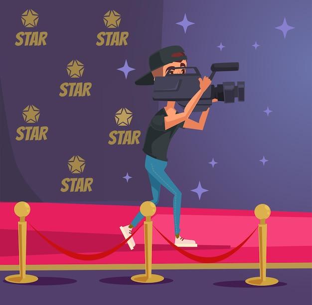 Postać operatora z kamerą na ceremonii czerwonego dywanu