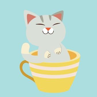 Postać ślicznego kota siedzącego w żółtej filiżance.