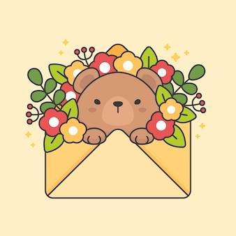 Postać słodkiego misia w kopercie z kwiatami i liśćmi