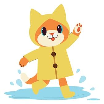 Postać uroczego kota nosi żółty płaszcz przeciwdeszczowy i buty.