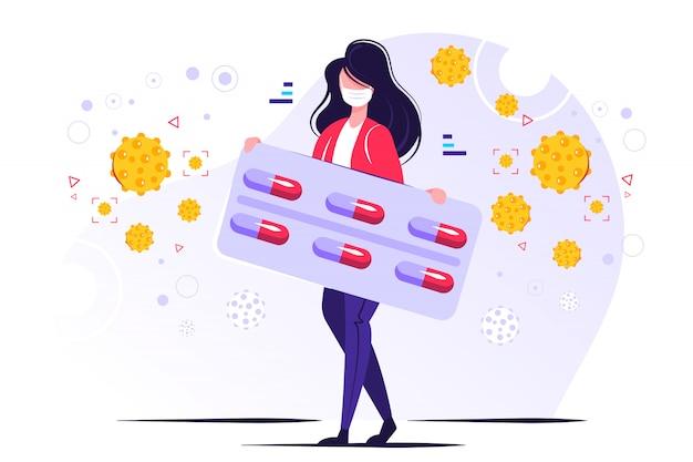 Postać w masce ochronnej i trzymająca blister tabletek