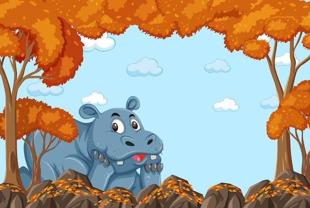 Postać z kreskówki hipopotama w pustej jesiennej scenie leśnej