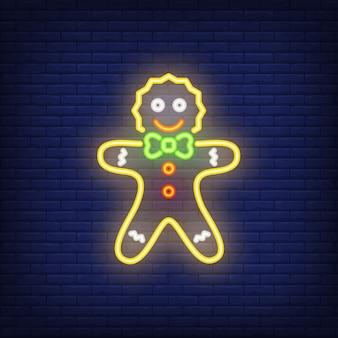 Postać z kreskówki piernikowego mężczyzna neon. noc jasny element reklamy.