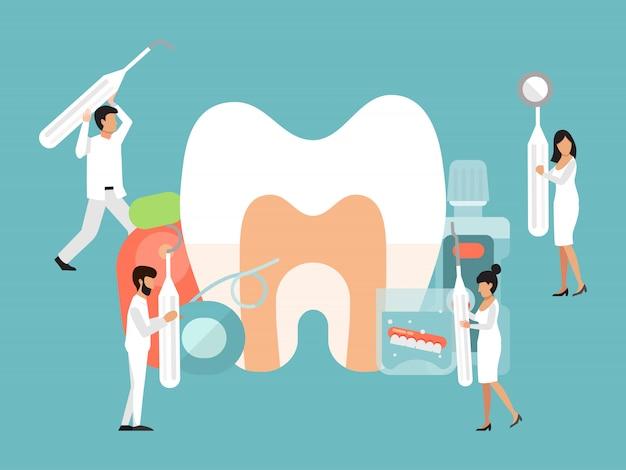 Postaci małych dentystów. opieka stomatologiczna przez mały sztandar lekarzy. dentysta z narzędziami dba o duży ząb