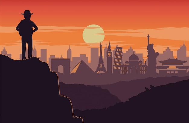 Poszukiwacz przygód stoi na szczycie góry
