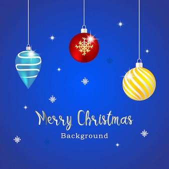 Potrójna świąteczna kula z niebieskim tłem