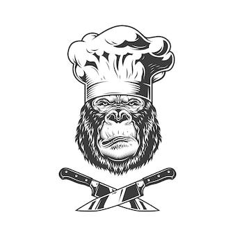 Poważna głowa goryla w czapce szefa kuchni