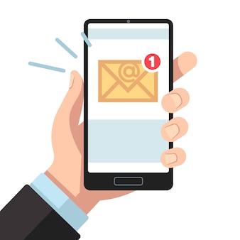 Powiadomienie e-mail na smartfonie w dłoni. skrzynka odbiorcza nieprzeczytana poczta, nowe wiadomości e-mail.