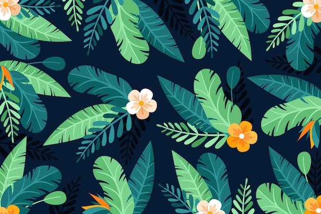 Powiększ tło z tropikalnymi kwiatami i liśćmi