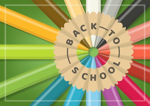 Powrót do koncepcji szkoły z realistycznymi wielokolorowymi drewnianymi ołówkami w okrągłym wyrównaniu na zielonym tle.