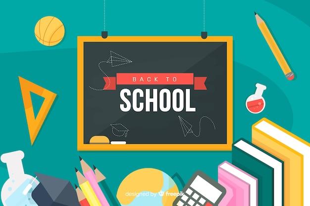 Powrót do szkoły na tablicy i przybory szkolne