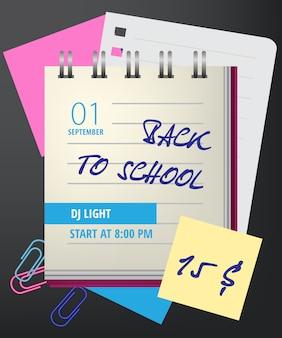 Powrót do szkoły napis z notatnikiem i spinacze do papieru
