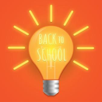 Powrót do szkoły neon light bulb świecące na niebieskim tle.