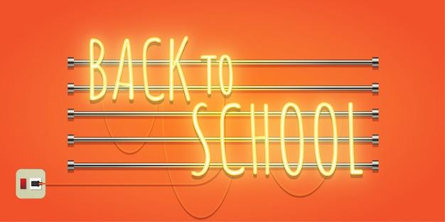 Powrót do szkoły neon świecący na pomarańczowym tle.