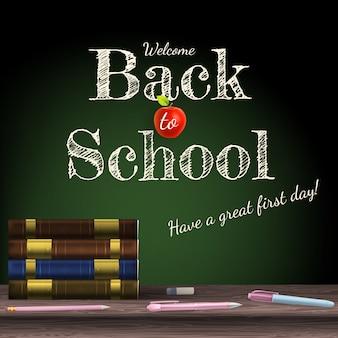 Powrót do szkoły, podręczniki szkolne z jabłkiem na biurku.
