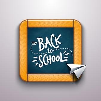 Powrót do szkoły rysowanie tekstu kolorową kredą na tablicy z papierowym samolotem.