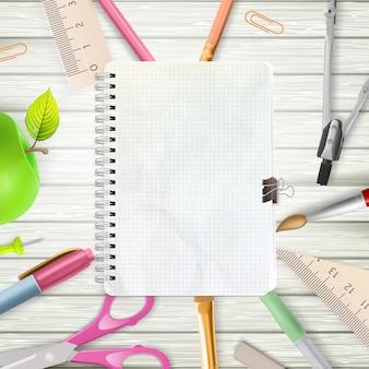 Powrót do szkoły tło z przyborów szkolnych i notebooka