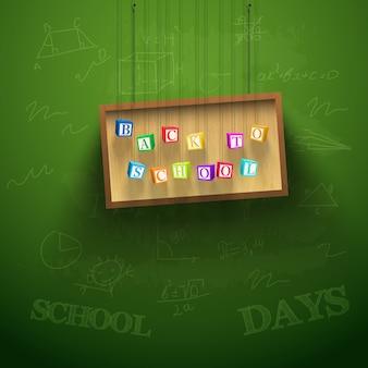 Powrót do szkoły tło z wiszącą tablicą i kolorowe kostki z literami