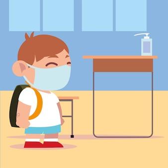 Powrót do szkoły, uczeń chłopiec w klasie z ilustracją odkażacza rąk dozownika
