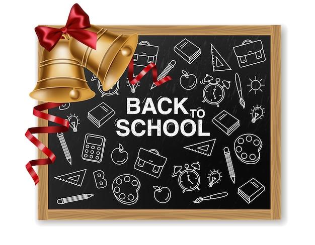 Powrót do szkoły ze złotym dzwonkiem i tablicą kredową