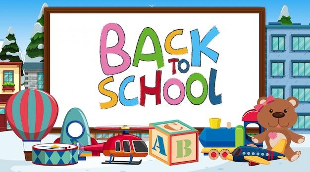 Powrót do szkoły znak z wieloma zabawkami