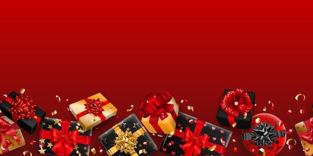 Powtarzające się czarno-złote pudełka na prezenty ze wstążkami