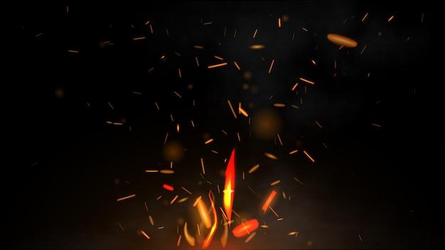 Pożar latające iskry na czarnym tle