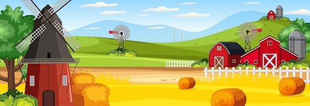Pozioma scena krajobrazu rolniczego ze stodołą i wiatrakiem
