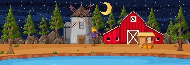 Pozioma scena pola uprawnego ze stodołą i wiatrakiem w nocy