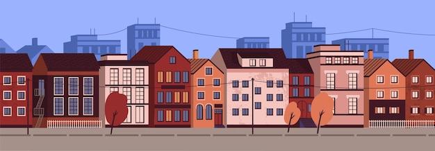 Poziomy krajobraz miejski lub pejzaż miejski z fasadami budynków mieszkalnych