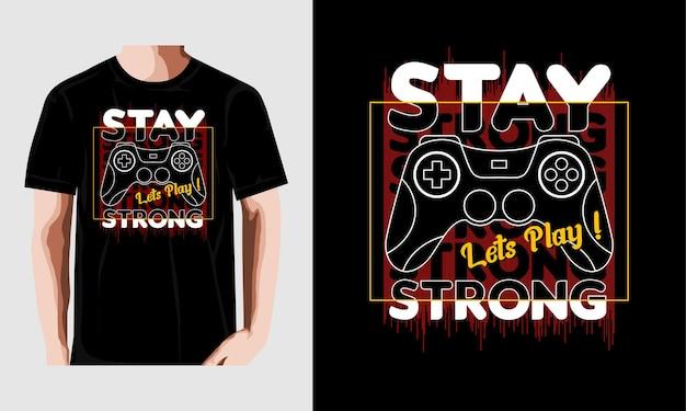 Pozostań silnym projektem gry typografii t shirt wektor premium