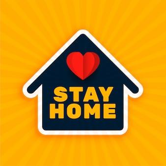 Pozostań w domu tło z symbolem domu i serca