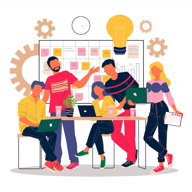 Pozytywni pracownicy biurowi dyskutuje pomysły z laptopami