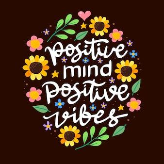 Pozytywny umysł i wibracje ręcznie rysowane napis motywacyjny cytat z kwiatowym elementem