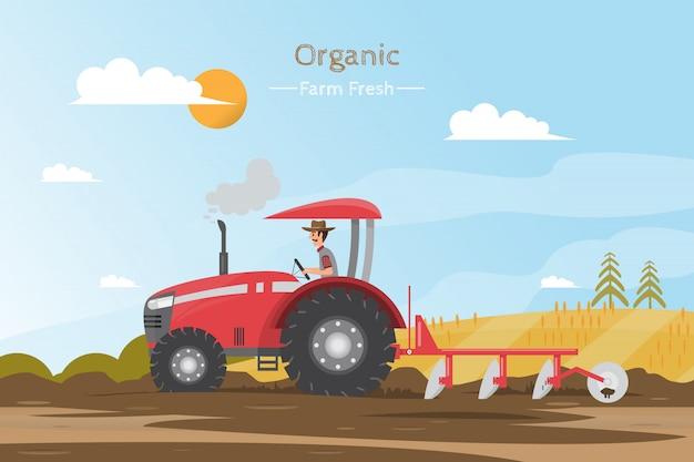 Praca rolnicza na polu z ciągnikiem.