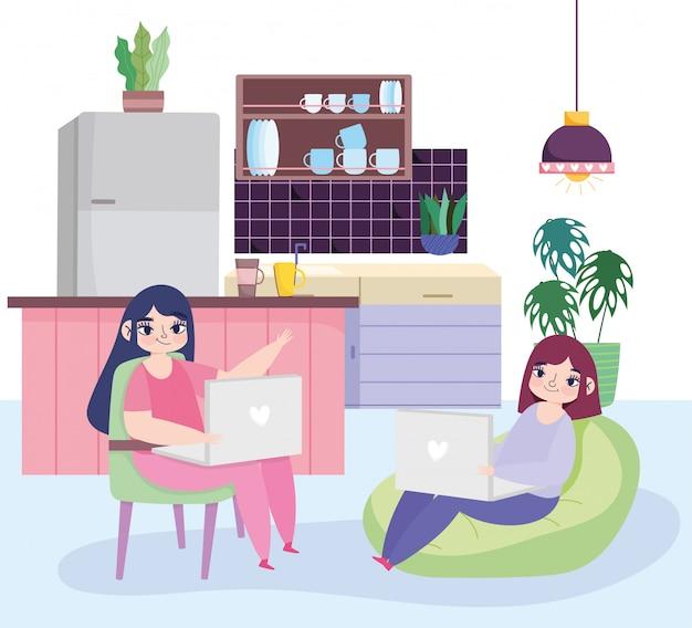 Praca zdalna, młode kobiety korzystające z laptopa w kuchni