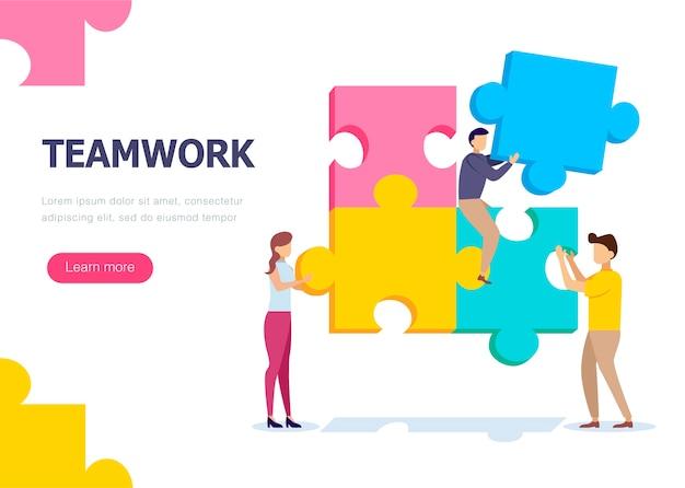Praca zespołowa ludzi, którzy zbierają puzzle.