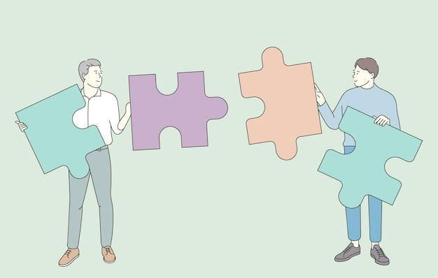 Praca zespołowa, wspólna koncepcja. zespół współpracowników partnerów biznesowych zbiera puzzle w poszukiwaniu rozwiązania.
