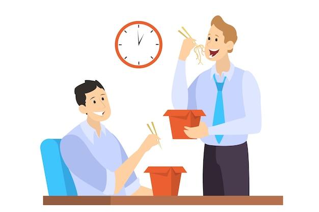 Pracownicy biurowi jedzą lunch podczas przerwy. grupa biznesmenów rozmawia podczas jedzenia.