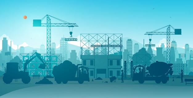 Pracownicy budujący domy z dźwigami na placach budowy.