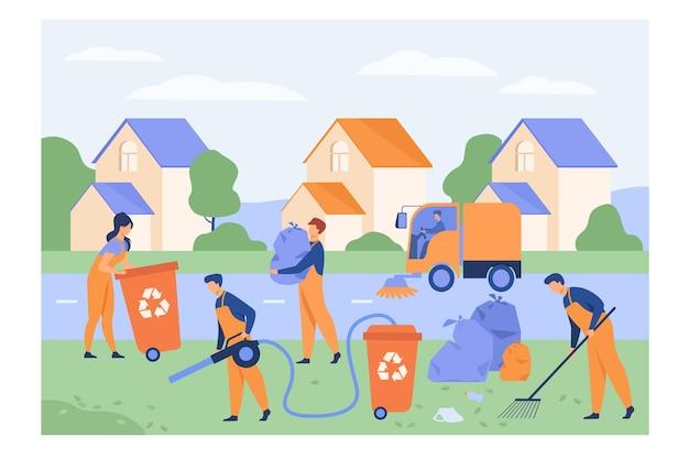Pracownicy sprzątający zbierający śmieci na podmiejskiej ulicy, myjący ulice, przenoszący torbę ze śmieciami do kosza