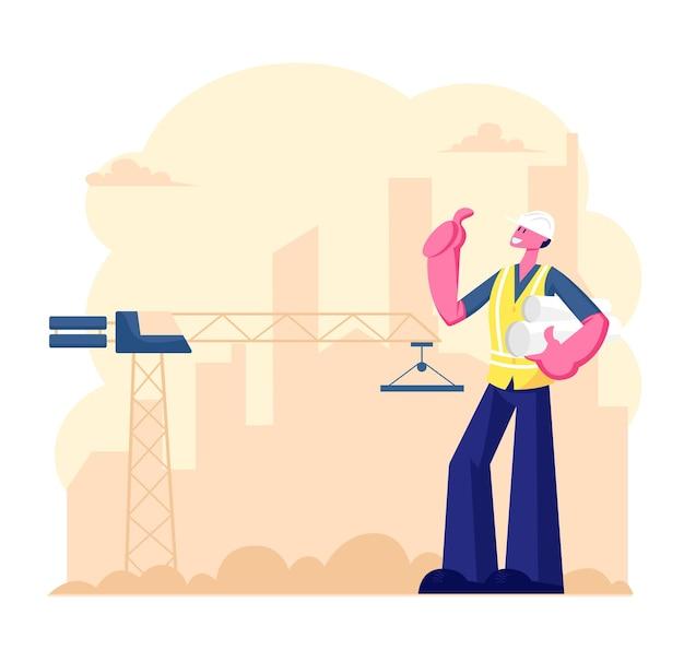 Pracownik architekta lub inżyniera w hełmie trzymający plan projektu stojak na placu budowy z działającym dźwigiem